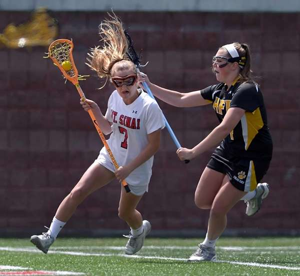 Mount Sinai's Meaghan Tyrrell, left, is defended by