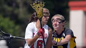 Mount Sinai's Caroline Hoeg, left, is defended by