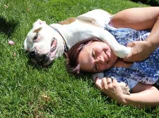 Sharon Faucett with her dog Duffy, a cancer-stricken