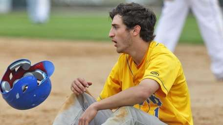 West Islip's Jon Risedorf is out at first