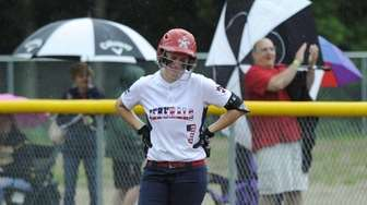 MacArthur's Jess Lombardo (7) walks off after being