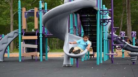 Christopher Ventura, 4, of Central Islip, plays at