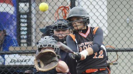 East Rockaway's Marissa Felbinger (12) gets hit against