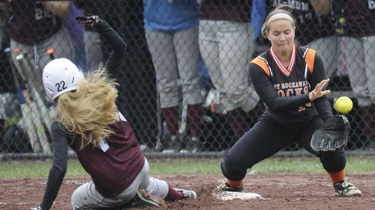 East Rockaway's Jessica Loyer (15) can't make the