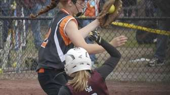 East Rockaway's Emily Chelius tries unsuccessfully to tag