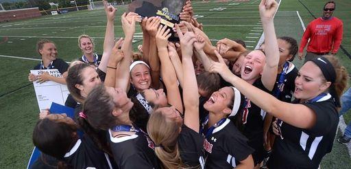 Mount Sinai players hoist the championship plaque following