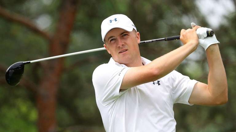Jordan Spieth watches his tee shot on the