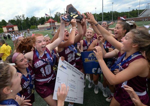 Garden City players raise the championship plaque following
