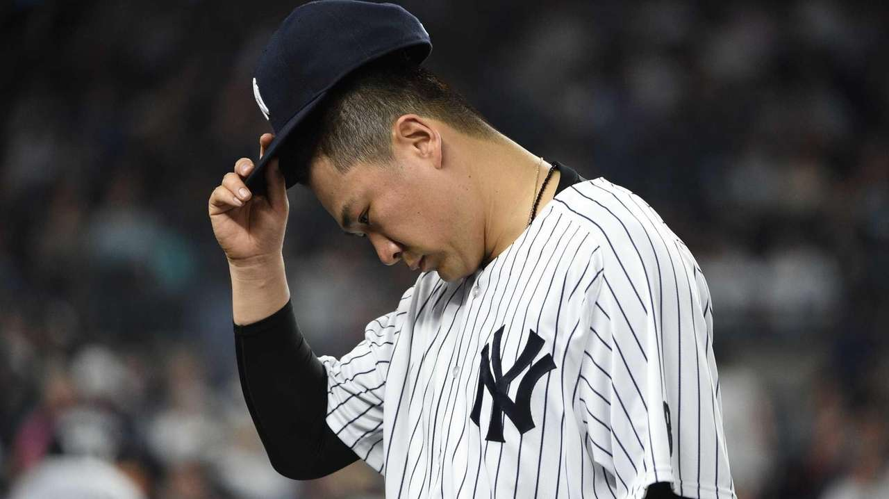 New York Yankees starting pitcher Masahiro Tanaka walks