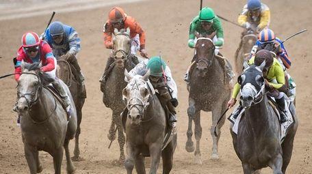 Jockey Irad Ortiz, Jr riding Creator, center in
