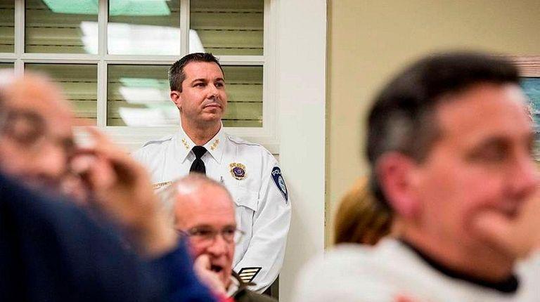 Westhampton Beach Village Police Chief Trevor Gonce listens