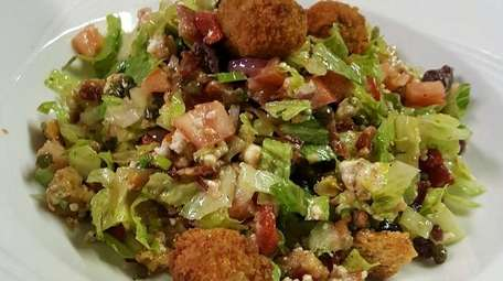The chopped romaine salad at Skipper's includes bacon,