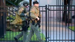 Orange County Sheriff's Department SWAT members arrive to