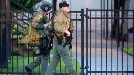 Orange County Sheriff's Department SWAT members arrive to