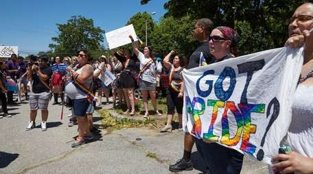 People participate in the Long Island LGBTQA+ Visibility