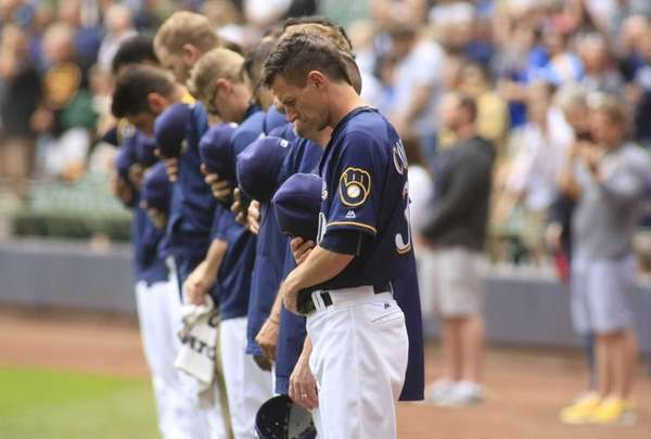 Members of the Milwaukee Brewers take a moment