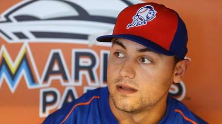 Michael Conforto of the New York Mets sits