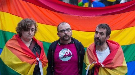 Members of a Paris anti-homophobia group display a