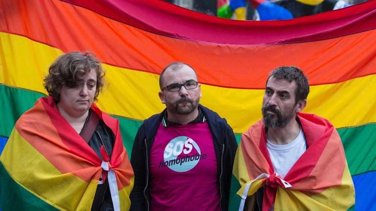 Members of a Paris anti-homophobia group display a