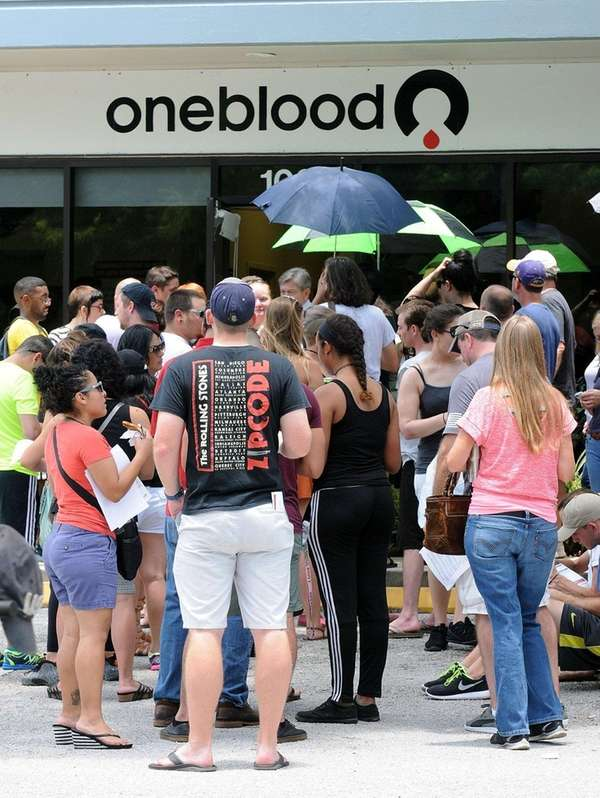 Long lines of people wait at the OneBlood