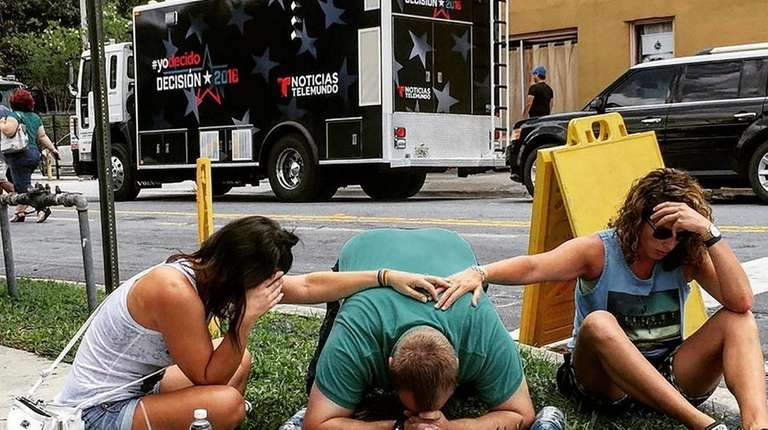 People mourning victims of the mass shooting in