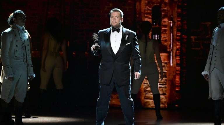 Host James Corden appears onstage during the 70th
