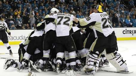 The Pittsburgh Penguins celebrate after their 3-1 victory