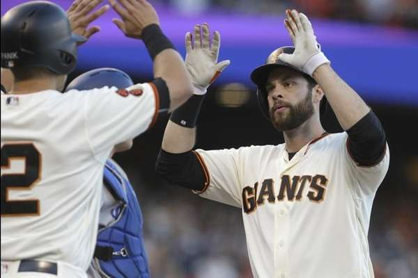 San Francisco Giants' Brandon Belt, right, celebrates with