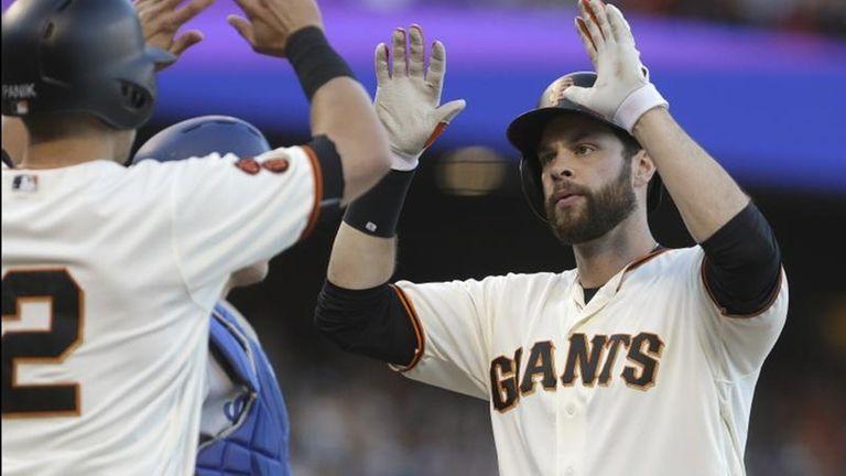 San Francisco Giants' Brandon Belt, right, celebrates with