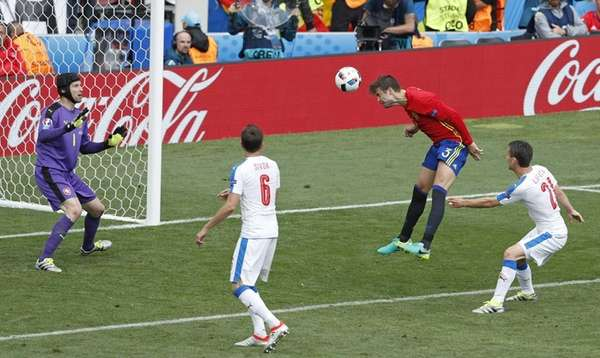 Spain's Gerard Pique, second right, scores the opening