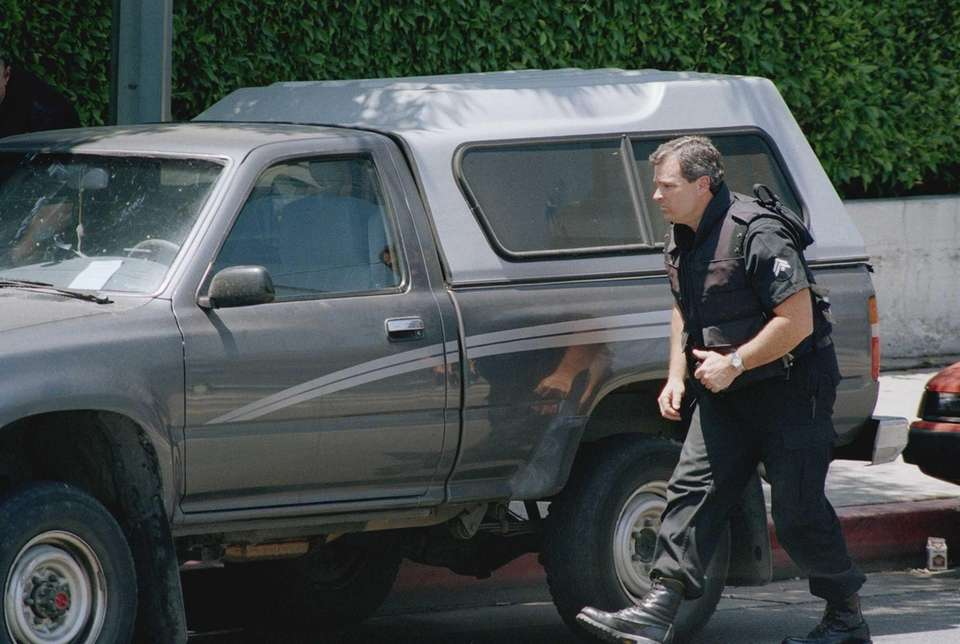An unidentified Los Angeles Police officer investigates after