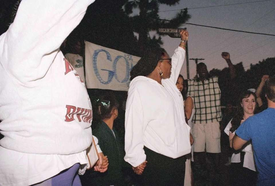 Cheering O.J . Simpson fans holding a