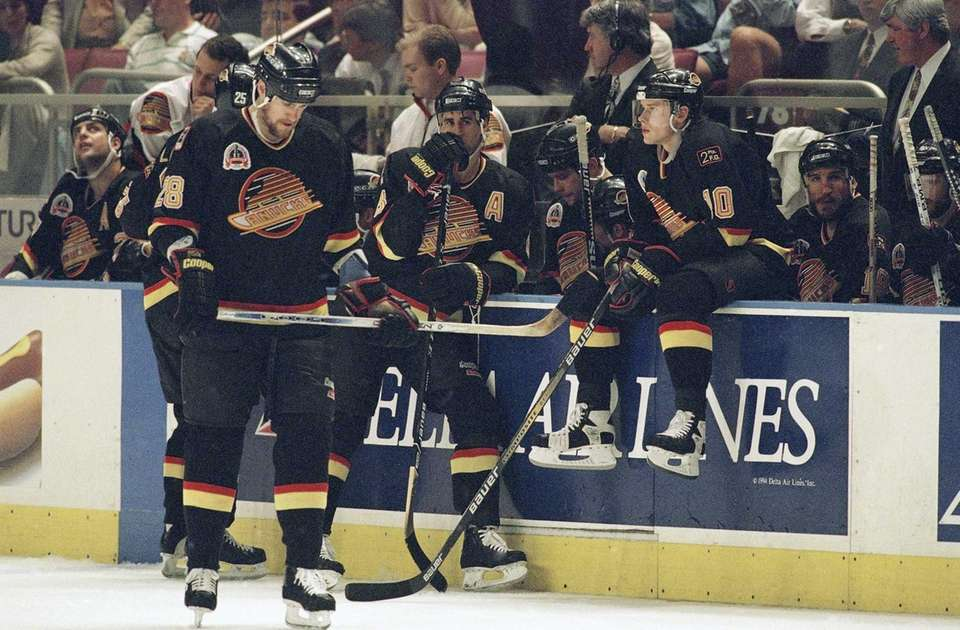 From left, Vancouver Canucks' Brian Glynn (28), Greg