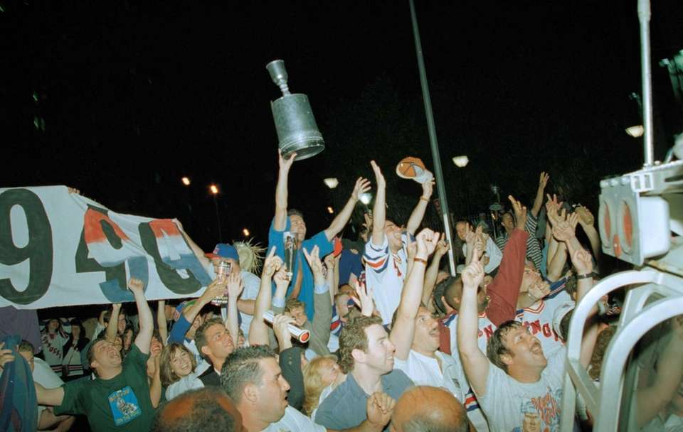 Rangers fans celebrate outside in the streets after