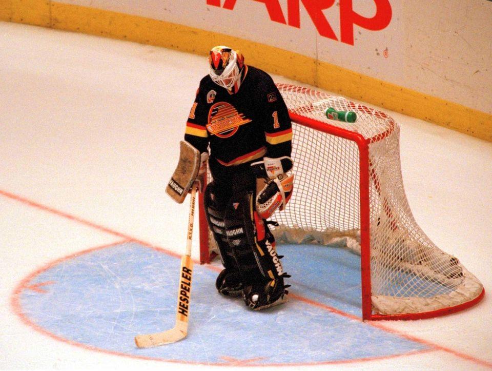 A dejected Vancouver Canucks goalie Kirk McLean stands