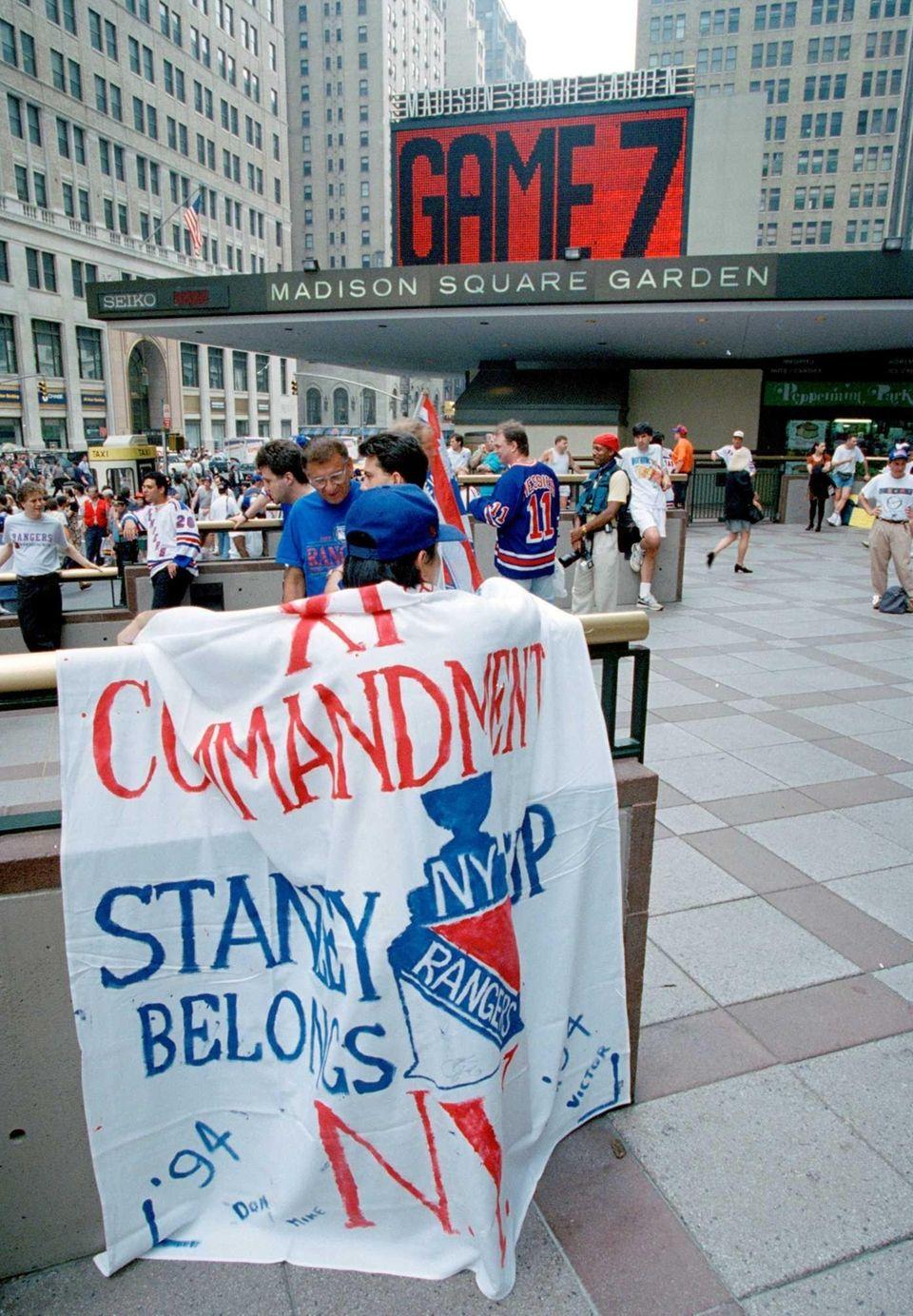 Rangers fan Michael Ten wears a banner prior