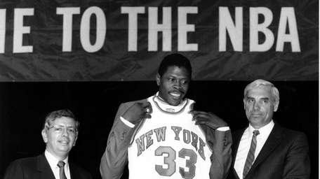 Patrick Ewing accepts his Knicks jersey from Dave