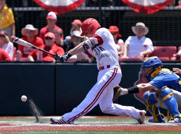 Louisville's Nick Solak hits a grounder during the