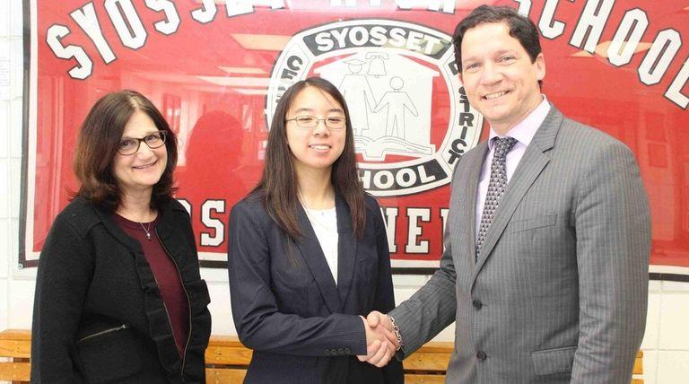 Syosset High School sophomore Wanlin Li, center, is