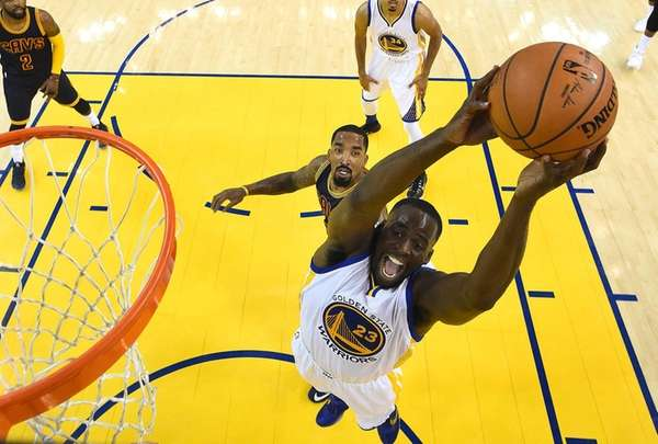 Golden State Warriors forward Draymond Green shoots in