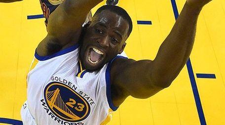 Golden State Warriors forward Draymond Green shoots in