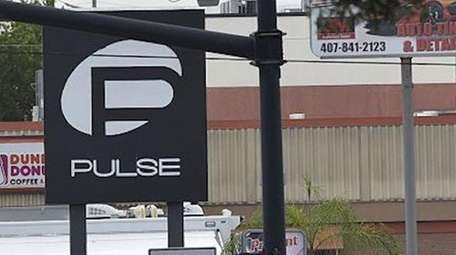 Orlando police officers outside Pulse nightclub after a