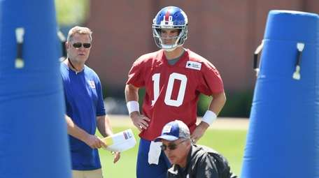 New York Giants quarterback Eli Manning looks on