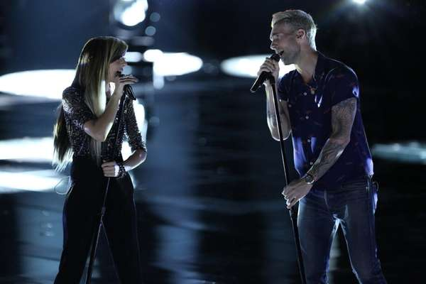 Christina Grimmie and Adam Levine perform on