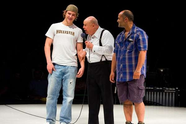 Comedian Don Rickles chastises two young guys from