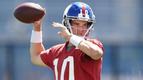 Giants quarterback Eli Manning winds up during OTAs