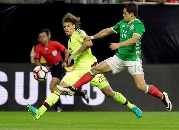Venezuela defender Rolf Feltscher (20) and Mexico forward
