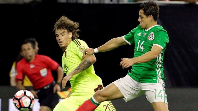 Venezuela defender Rolf Feltscher (20) and Mexico forward