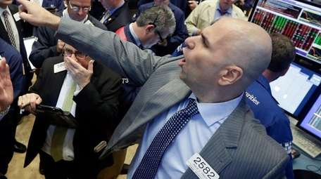 Specialist Philip Finale, right, directs trading in LinkedIn
