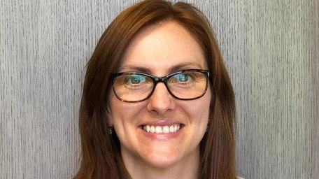 Marlena Wozowicz of Riverhead has been hired as